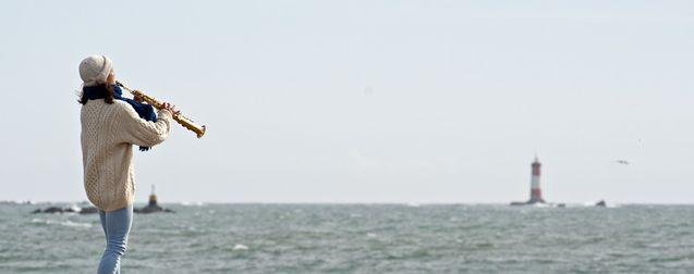 Photo Souffler plus fort que la mer